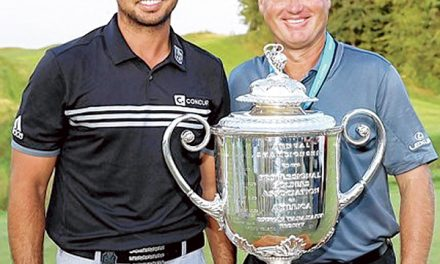 Bluffton's Colin Swatton: Caddie for No. 1 Jason Day