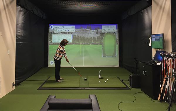 Practice golf swing indoors during winter months