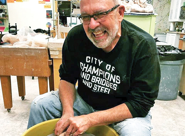 Holsinger left his mark on thousands of clay pots – and students