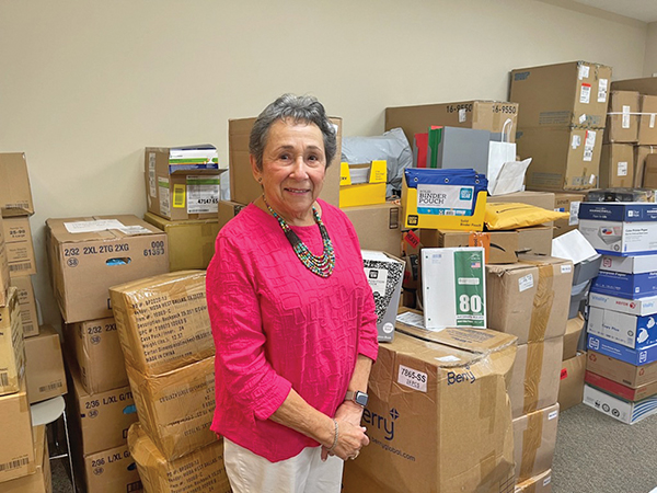 Cypress residents give back to staff by filling backpacks
